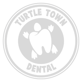 white logo for turtle town dental